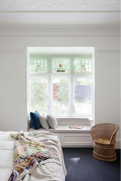 Built-in love seat in living room window