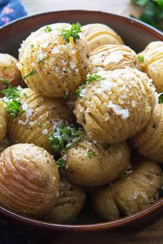 Mini Roasted Hasselback Potatoes Recipe - sliced creamer potatoes baked until golden brown, then drizzled with olive oil, salt, pepper, and parsley