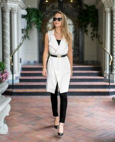 white knee length vest + black blouse + black ankle pants