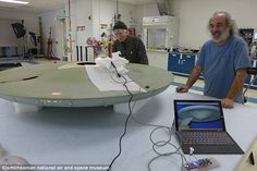Museum specialists Zabih Sadighian (right) and Larry Berger do the first tests of LED ligh...