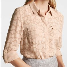 Ann Taylor Animal Jacquard Button Down Camp Shirt Like new. This iconic camp shirt takes a style safari this season in dressed-to-thrill animal jacquard. Point collar. Long sleeves with button tabs. Hidden button front. Front flap chest pockets. Shirttail hem. Ann Taylor Tops Blouses