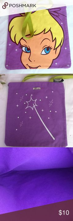 ✨Disney Tinker Bell Bag✨ Never Been worn with tags Disney bag                  - Has a Tinker Bell design in front of the bag        - Has a wand and sparkle design in the back         - Has no pockets and a small tag that says Florida on back                                                        - Has a purple inside with two green straps in very good condition Disney Accessories Bags