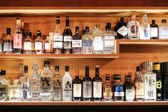 A peek at their impressive collection on their bespoke wood shelving, Cafe Slatkine Geneva. Wood Shelves, Shelving, Geneva, Wine Rack, Bespoke, Liquor Cabinet, Collection, Home Decor, Diy Wood Shelves