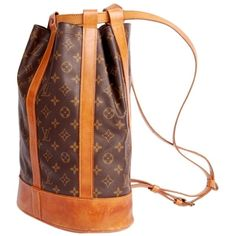 Pre-owned Louis Vuitton Randonnee 2355 Backpack ($595) ❤ liked on Polyvore featuring bags, backpacks, brown, louis vuitton, monogrammed backpacks, laptop rucksack, laptop bag and shoulder strap backpack