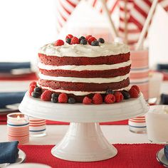 Striped Red Velvet Cake - Red velvet cake and fluffy cream cheese frosting are already a perfect pair, but fresh blueberries and raspberries add the perfect patriotic touch for this of July dessert. Patriotic Desserts, Blue Desserts, 4th Of July Desserts, Just Desserts, Colorful Desserts, Fluffy Cream Cheese Frosting, Cake With Cream Cheese, Cupcakes, Cupcake Cakes