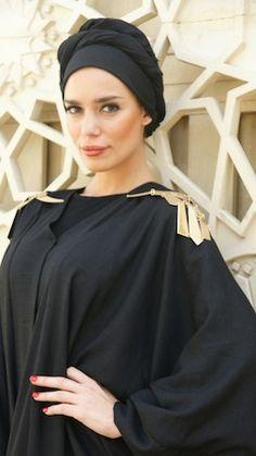 Hessa Alfalasi, in a gold embellished abaya