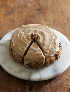 moist carrot cake with a spiced maple frosting is vegan and free from gluten and refined sugars!
