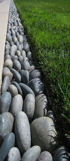 5 Creative Ways to Edge Your Landscape! I'll be trying industrial edging material and the rocks under the hurricane fencing bordering my neighbors yard in the back. Looks nice and it would be great not to have to reach under the fence or walk around the block to weed from his yard.