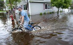 Biking in flooded Carlton, Minn.