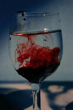 this could show signs of depression by the blood dropping into the glass, which could be from their wrists.