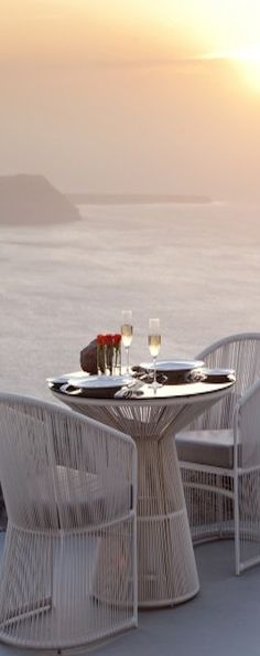...Santorini - Champagne and a gorgeous view at dusk!   ASPEN CREEK TRAVEL - karen@aspencreektravel.com