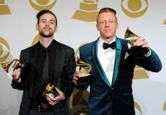 GRAMMY winners Macklemore and Ryan Lewis celebrate backstage at the 56th Annual GRAMMY Awards on Jan. 26 in Los Angeles