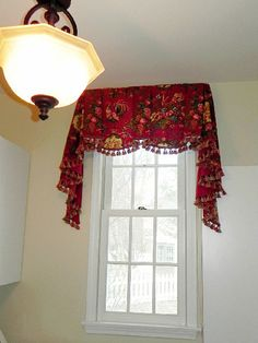 This sheffield valance could look like it is floating along the top of this long and narrow window.  The long tails (or jabots) coming down to the half way point of the window help balance the look without the need for side panels.
