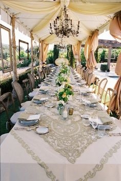 Lace tablecloth for wedding reception {Photo: XOXO Bride via Project Wedding}