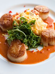 Try Glenmorgan's Seared Jumbo Sea #Scallops with creamy lobster & goat cheese polenta, sautéed arugula, and lobster nage from their Valentine's Day Dinner menu.