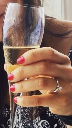 A diamond engagementring and champagne, what more could a girl want!  #engagementring #champagne #engaged #engagementrings #proposal #diamondring #shesaidyes #heputaringonit #diamond
