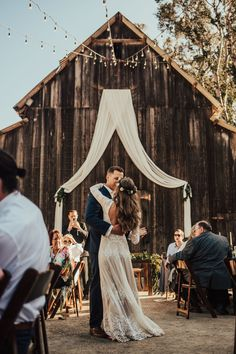 This rustic barn-themed wedding reception, but with a thousand more overhead + hanging fairy lights