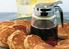 Drop scones are an almost instant snack or breakfast treat. The thick batter is made by simply stirring together a few basic pantry ingredients, and the scones cook in minutes. Here they are flavoured with diced apple and toasted hazelnuts. Top with a little light maple syrup and enjoy warm from the pan.