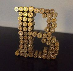 Simply Extraordinary DIY Letter Decor Here to Enhance the Aesthetic Values of… Bullet Casing Crafts, Bullet Crafts, Shotgun Shell Crafts, Shotgun Shells, Shotgun Shell Cake, Ammo Crafts, Redneck Crafts, Bullet Shell, Bullet Art