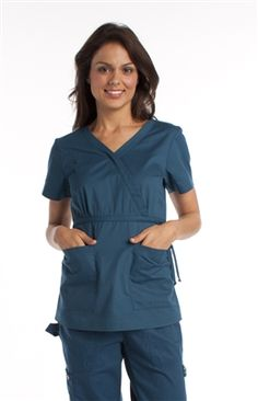 Koi Katelyn Mock-Wrap Top -- Our #1 Selling Top Katelyn Because some things never go out of style! Our Price: MXN $495.00 Koi, Womens Scrubs, Scrub Tops, Out Of Style, Going Out, Cold Shoulder Dress, Rompers, Caribbean, Casual