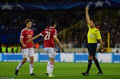 Manchester United midfielder Herrera receives a yellow card from fellow countryman Antonio Mateu Lahoz after just 13 minutes