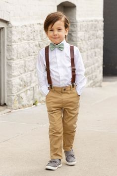 These sage bow tie and brown leather suspenders make a great ring bearer outfit. Ring Bearer Suspenders, Ring Bearer Outfit, Country Wedding Rings, Navy Rings, Leather Suspenders, Red Pants, Baby Size, Leather Material, Poplin Fabric