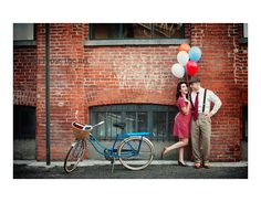 Love this vintage look for engagement photos...suspenders and a cute dress make the shot.