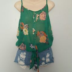 Sheer Green Floral Tank Top Excellent condition. 100% Polyester. Bottom has elastic stretch all the way around. Fast shipping! Thank you for shopping my closet! Xoxo Tops Tank Tops