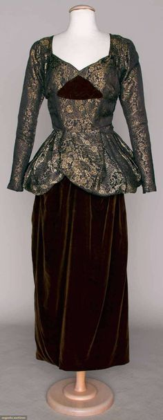 "PURPLE LAME BROCADE GOWN, c. 1910 Purple & gold lame peplum bodice & back panel, plum velvet skirt, square back train (photo'd w/ train snapped up, lame slightly tarnished) B 34"", W 26"", L 58"", very good. BM via Augusta Auctions"