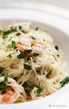 So easy! 30-minute recipe. Angel hair pasta tossed with shrimp in a Parmesan lemon cream sauce. On http://SimplyRecipes.com