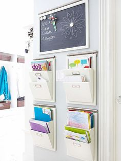 Tack on a mail holder for every member in your household to organize their mail in, so you won't get yours mixed up.   Source: Better Homes and Gardens