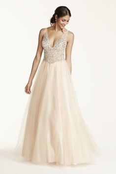 Prom will be a night to remember in this over-the-top beaded prom dress. Style DB07 at David's Bridal.