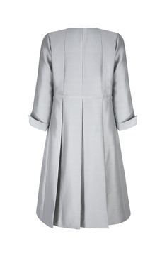 Suzannah.com: Trapeze Line Coat Silver Grey Silk £950.00. The perfect tailored outer layer to complete a chic outfit for a wedding or event. Gentle A-Line silhouette with round neck and concealed front button fastening. Deep pleat detail at the back of the garment to give movement and charm. Neat side pockets. Light-mid weight silk with wool content. Gentle sheen cloth with a subtle slub texture.