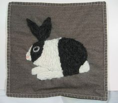 Mohair yarn made this bunny pillow cover very usable. Sold