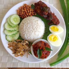 And we're done! Dish up the hot coconut milk rice on a plate and serve alongside with all the other side dishes. So Enjoy! For more, visit http://www.huangkitchen.com/nasi-lemak-coconut-milk-rice/