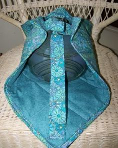 Casserole Carrier- my hubby's grandma made me one of these and I LOVE it! it fits almost any medium-sized dish