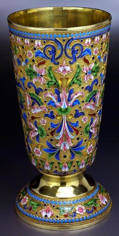 Large gilded silver and shaded cloisonne enamel beaker by Dmitry Nikolaev, made in Moscow between 1899 and 1908, enameled with multi color stylized foliage on a gilded stippled ground.   Height 6 3/8 in. (16,2 cm)