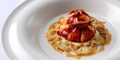 Lobster tail is poached in succulent stock in this recipe by William Drabble. Caramelised and puréed cauliflower round out this delicious lobster recipe.