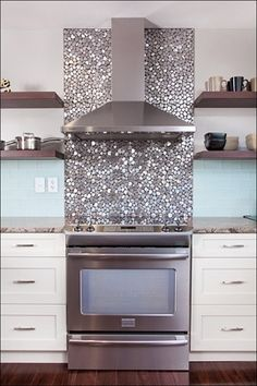 Beautiful use of tile to glam up your kitchen space, love it!