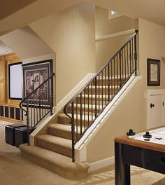 open stair railing into basement would make it feel more open to both sides of the stairway