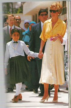 May 12, 1992:  HRH Diana, Princess of Wales holds the hand of a ten year old polio sufferer, Heba Salah, when she visited the Institute of Polio & Rehabilitation in Cairo, Egypt.
