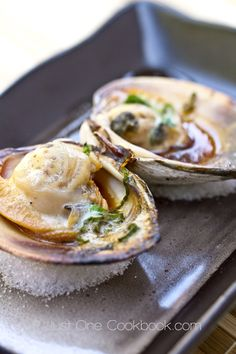 Barbecued giant little neck clam with soy sauce, butter, mirin, and sake. Perfect summer grilled appetizer