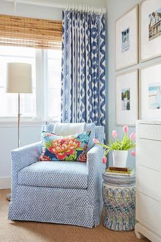 A blue slipcovered accent chair topped with a floral lumbar pillow sits in a corner on a seagrass rug between a floral stool and a polished nickel floor lamp. Home Living Room, Living Room Decor, Living Spaces, Blue Accent Chairs, Blue Chairs, Interior Decorating, Interior Design, Southern Decorating, Interior Styling