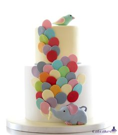 elephant with balloons - Our mother always says she want a children style cake, so we surprise her with this one in her 60th birthday. Carrot cake for her and chocolate cake for us ^^