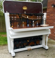 Please go like and share CJs Custom Piano Bars on Facebook. You can copy/paste (https://www.facebook.com/cjscustompianobars). 1911 HP Nelson Upright Piano repurposed into a bar. Features: - Rubber casters/wheels to prevent scratches on hard wood floors - Dual wheel casters which make it easier to move - Copper countertop that has the ability to open & shut - 18 bottle wine rack - 8 glass wine glass holder - Recessed interior shelf to allow other, taller bottles (liquor/mixers) to be on…