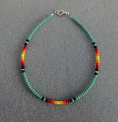 "Turquoise Sunburst Beaded Anklet. in color Turquoise with sunburst colors black,red,orange,yellow & white. Your size is to measure your ankle and add 1/2"" for comfort. a well-made Native American made item as I take much pride in my work. 