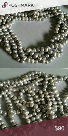 LONG Single Strand of Freshwater Pearls Very long, individually knotted freshwater pearls. About 80 inches in length so you can wear it a variety of ways. This is heavy! Jewelry Necklaces