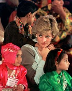 Britain's Princess of Wales sits with sick children, during a visit to the Shaukat Khanum Memorial Hospital, founded by Pakistani cricket star Imran Khan, in Lahore, Thursday Feb. 22, 1996