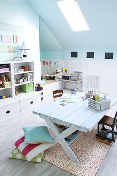 Beautiful craft room. That recycled door desk that I plan to DIY will look perfect designed like this, in a craft room/playroom downstairs in what used to be my living room!