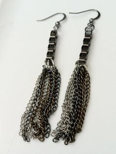 I love how edgy/tough these look.  Industrial Chain Tassel Earrings by AandJAcc on Etsy